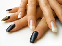 Hands. Black nails and white nails Stock Images