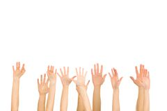 Hands. Many hands high up over white background Royalty Free Stock Photo