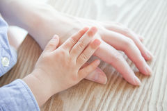 Hands. Parent and child who grasps its hand Royalty Free Stock Photo