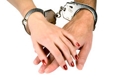 Hands. Of men and women in handcuffs, isolated on white Stock Photography
