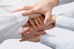 Hands. On top of each other. Symbolic picture royalty free stock image
