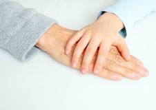 Hands. Young and old generation holding hands Royalty Free Stock Photo