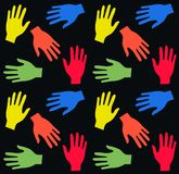 Hands. Colourful seamless hand pattern on black background colour Stock Photos