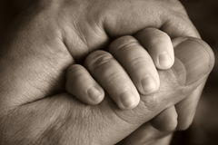 Hands. Father holding little baby hand Stock Photo