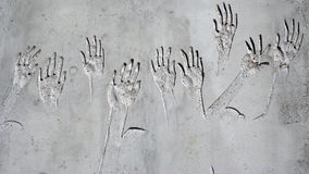 Hands. Relief hands on the stone wall Stock Image