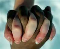Hands. Two people holding hands in harmony Stock Photos