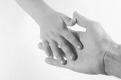 Hands. Two hands - adult and child.  Black and white image against a white background Stock Photography
