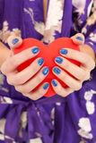 Hands. Beautiful woman's hands holding big red heart Stock Photo