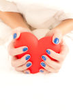 Hands. Beautiful woman's hands holding big red heart Stock Photos