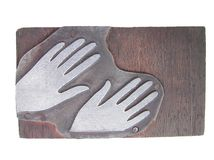 Hands. An old wooden printing block of hands etched in metal Royalty Free Stock Photo
