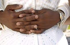 Hands. Of groom hugging bride Royalty Free Stock Image
