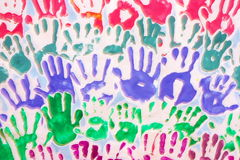 Hands. Many hand prints of children in different colors on white background stock illustration