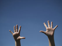 Hands. Open hands extended toward the blue sky Royalty Free Stock Photography