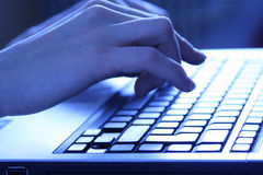 Hands. Type that that on the keyboard of a laptop Royalty Free Stock Images