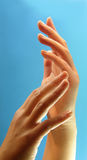 Hands. Beautifull hands backround light blue Royalty Free Stock Photography