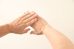 Hands of 70-year old man Stock Photos