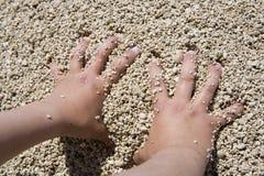 Hands. On the beach stock photos