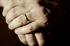 Hands. Which crossed of un' man with wedding ring Royalty Free Stock Image