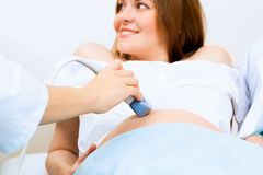 Hands and abdominal ultrasound scanner Royalty Free Stock Images