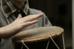 Hands above the drum Stock Images