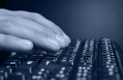 Hands above the keyboard Stock Photos
