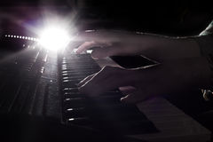 Hands above the piano Royalty Free Stock Photo