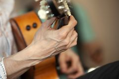 Hands of an acoustic guitar player. Close-up photo stock photos