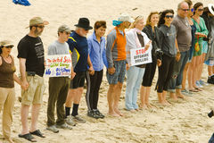 """Hands Across The Sand Rally. LOS ANGELES, CA-JUNE 26:  The """"Hands Across The Sand"""" participants lines up and join hands in protest of oil drilling in our oceans Royalty Free Stock Images"""