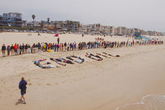 Hands Across The Sand Rally. LOS ANGELES, CA-JUNE 26:  The Hands Across The Sand participants lines up and join hands in protest of oil drilling in our oceans Royalty Free Stock Photos