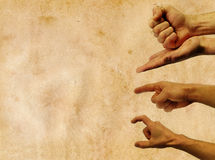 Hands in action against a vintage background with. Empty space Stock Photography