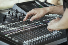 Hands adjust controls on sound mixer 3 Royalty Free Stock Images