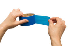 Hands of the adult female paste blue masking tape isolated royalty free stock photos