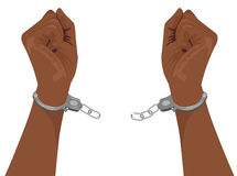 Hands of african american man breaking steel handcuffs. On white background Royalty Free Stock Image