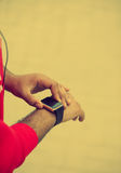 Hands of African male using smart wrist watch Stock Photography