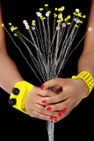 Hands of an African Woman hold White and Yellow Beaded Flowers Royalty Free Stock Photo