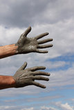 Hands against the sky. Hands on healing clay in the sky Royalty Free Stock Photo