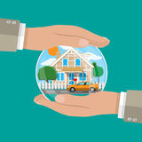 Hands of agent, protect house and car. Stock Images