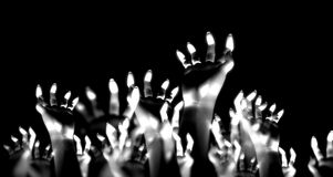 Hands In The Air. A crowed of hands reaching into the air Stock Images