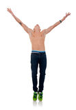 Hands in the air. Cool dancer standing on his tip toes with hands in the air Royalty Free Stock Images