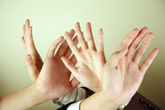 Hands in the air stock images