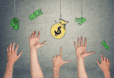 Hands in air tryong to reach banknotes and money bag, hanging on hooks. 5 Hands in the air tryong to reach the banknotes and a money-bag, hanging on the hooks Royalty Free Stock Images