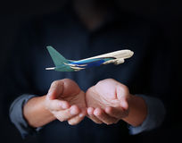 Hands and airplane Stock Photography