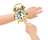 Hands and alarm clock like a watch Stock Photo