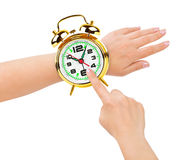 Hands and alarm clock like a watch Stock Photography