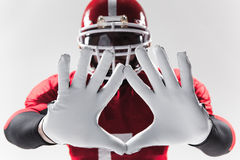 The hands of american football player on white Royalty Free Stock Image
