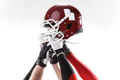The hands of american football players with helmet on white background Royalty Free Stock Images