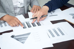 Hands and analysis diagram Royalty Free Stock Photo