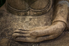Hands of ancient buddha statue Stock Image