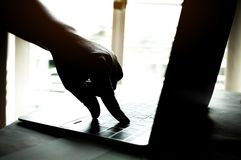 Hands of anonymous hackers typing code on keyboard of laptop for Stock Images