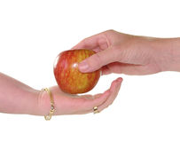 Hands and apple Royalty Free Stock Photos